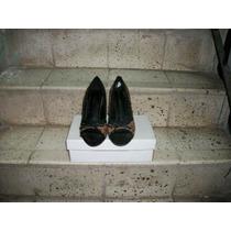 Zapatillas Marca Delicious (prácticamente Nuevas).