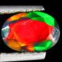 Opalo Negro Arlequin 0.79 Cts Oval Facetado