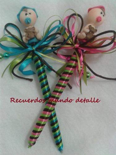 plumas decoradas con bebes recuerditos para baby shower